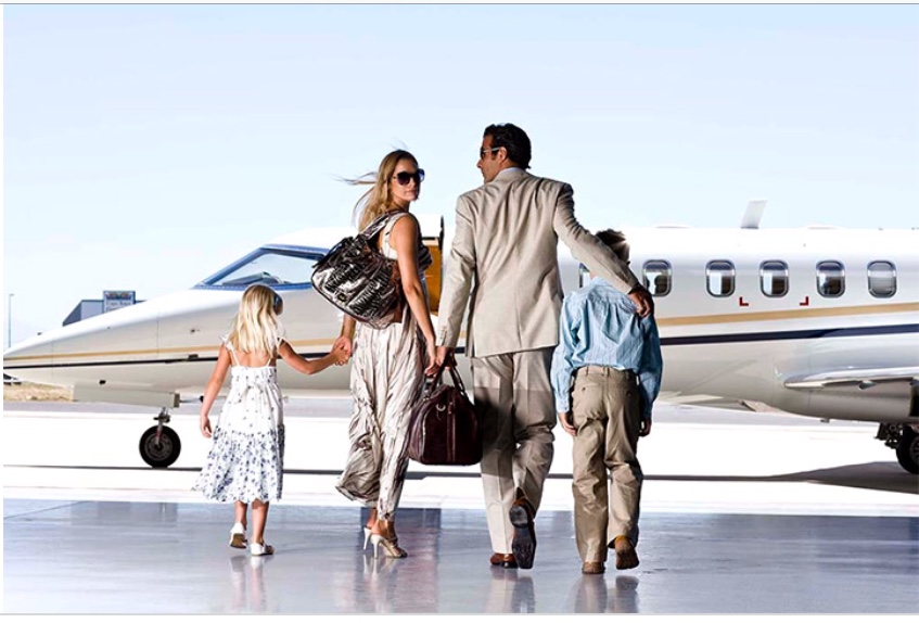 Family walking towards a private jet