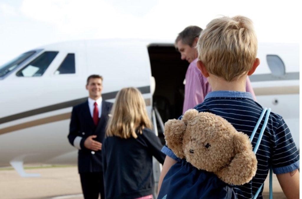 Family boarding private jet