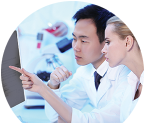 Information on HistoTrac Two Chemists looking at Monitor