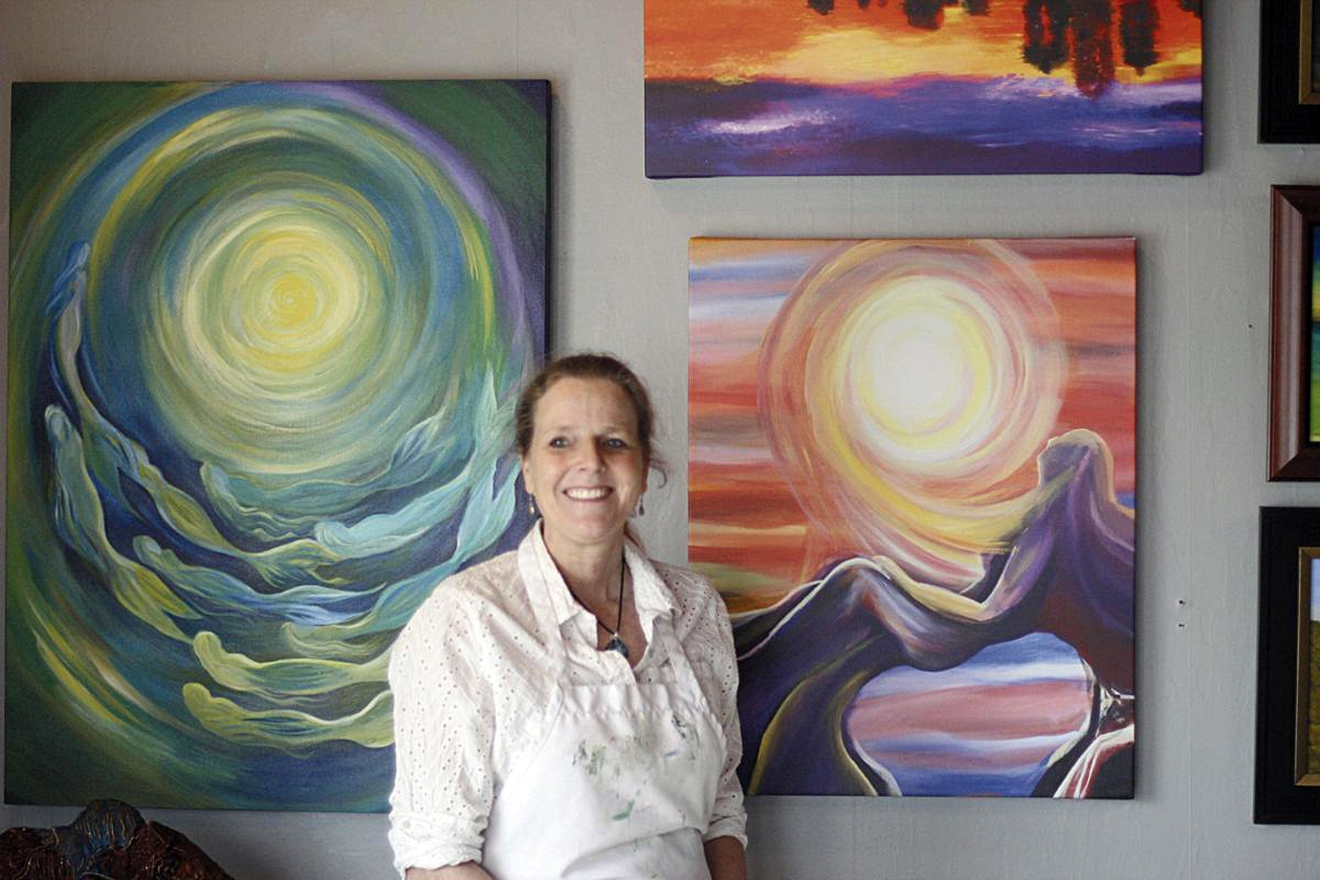 Art by Mary Case owner and artist, Mary Case, in her gallery in Ludington, Michigan.