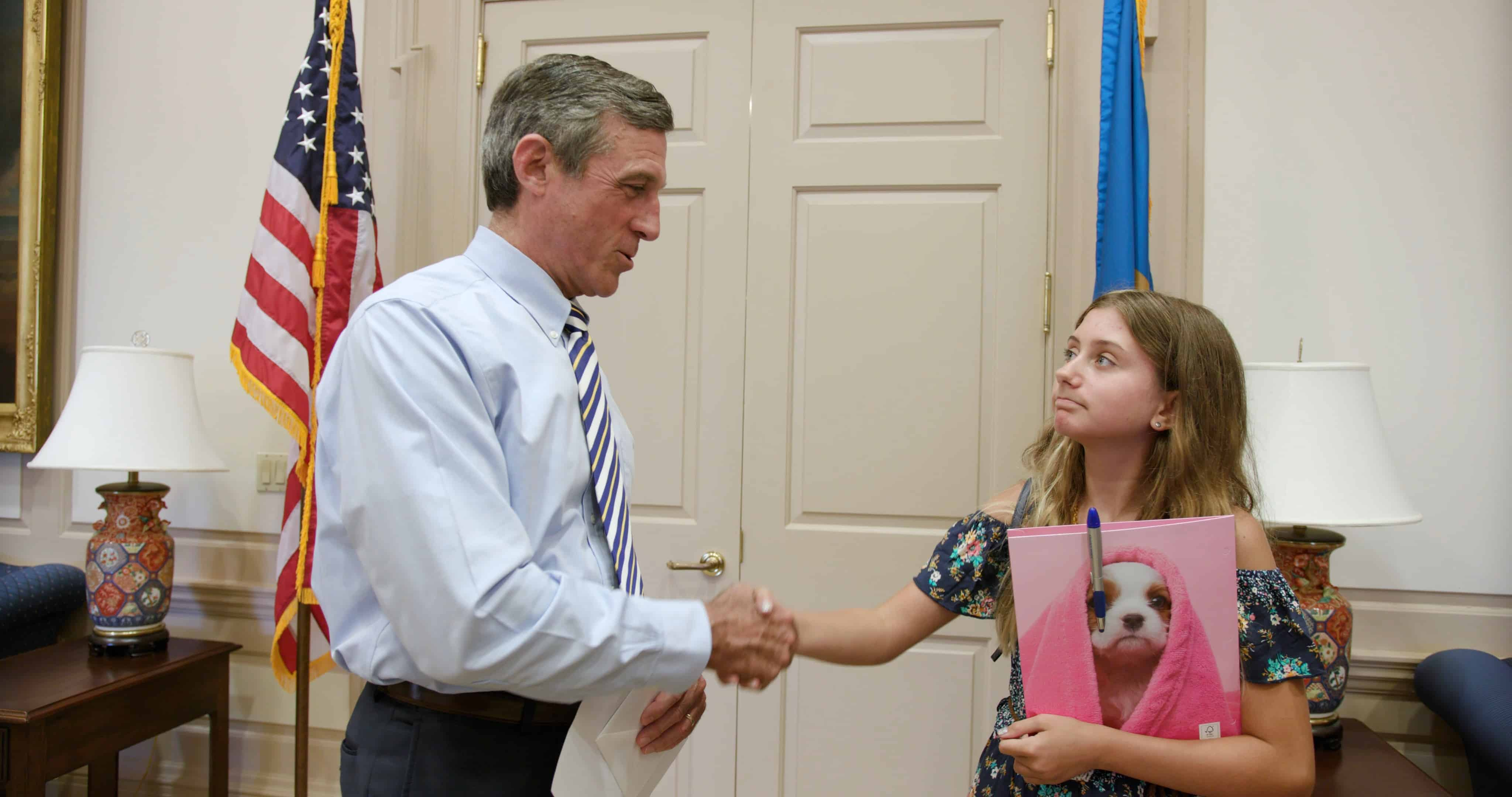 Rylie shakes hands with governor