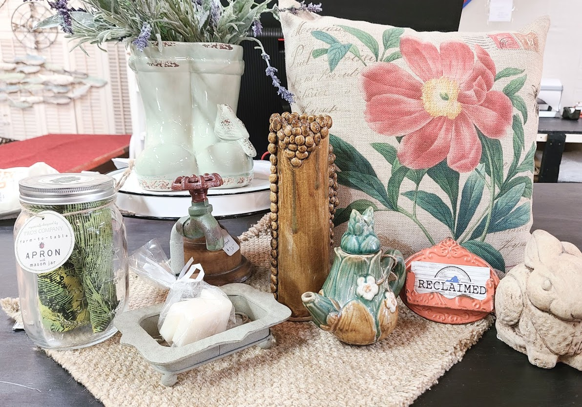 figurines, plants, and a pillow