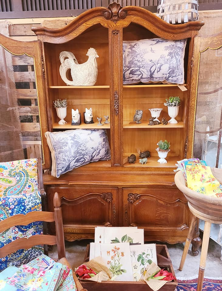 wooden cabinet with figurines