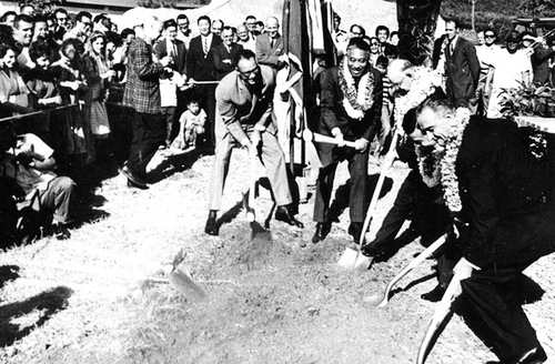 Vice president Lyndon B. Johnson, far right, breaks ground for the East-West Center in May, 1961. Assisting are, from left, Hawai'i governor William F. Quinn, U.S. senators Hiram L. Fong and Oren E. Long, and U.S. representative Daniel K. Inouye. (Image credit: University of Hawaii)