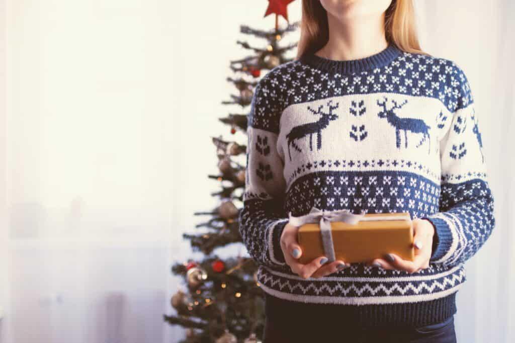 woman wearing ugly christmas sweater