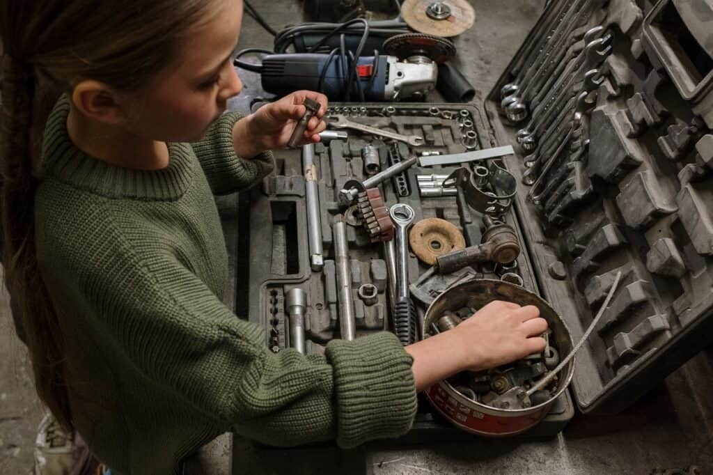 girl accessing mechanic tool set