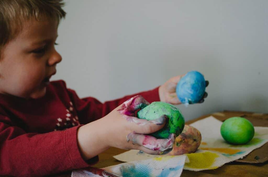 kid holding easter eggs