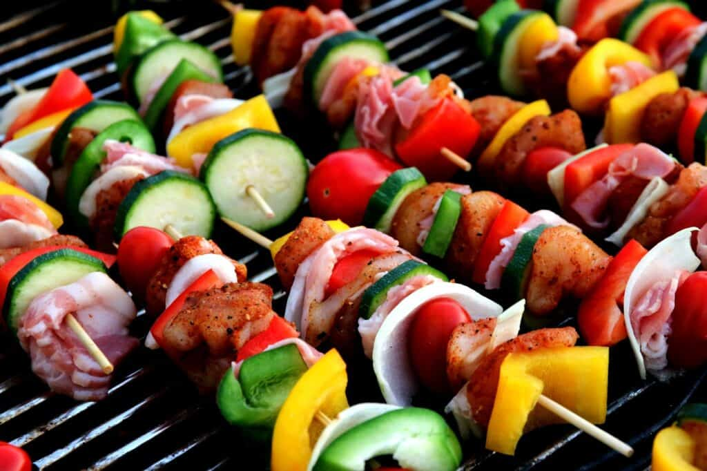 various foods being grilled