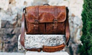 white rock holding leather messenger bag