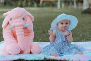 baby girl wearing blue sun hat