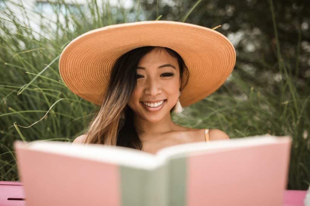 woman wearing brown straw sun hat
