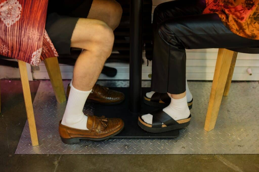 person wearing black sandals with socks