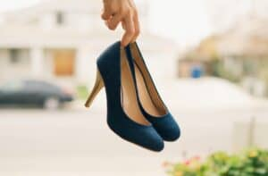 person carrying blue heels