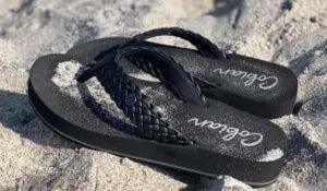 black platform sandals at beach