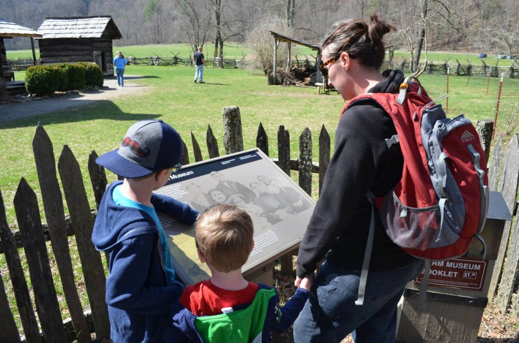 Abby and the kids checking out the map of an old homestead in the Great Smoky Mountain National Park.