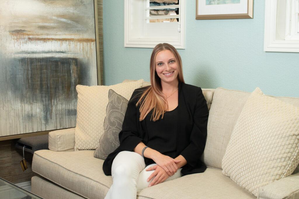 Kelsey Herrick of Kelsey Herrick Design sitting on a couch
