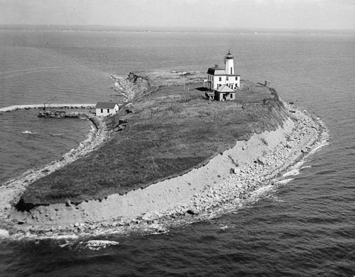 This aerial view (c. 1960s) shows the lighthouse, keeper's house and fog signal building (U.S. Coast Guard photo)