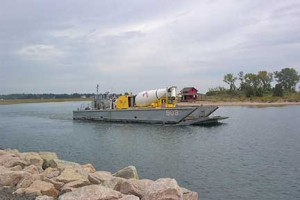 USF&WS ferries a cement truck to the island for repairs.