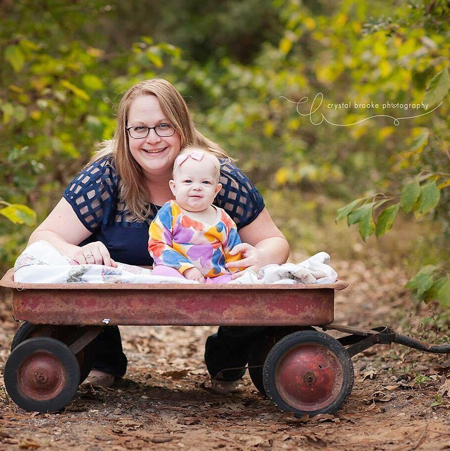 Picture of mother and baby with red wagon