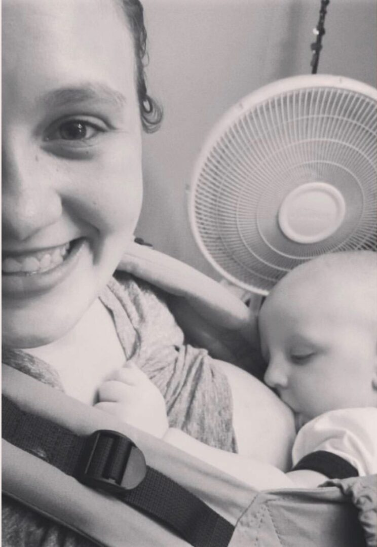 Picture of mother breastfeeding baby in a baby carrier