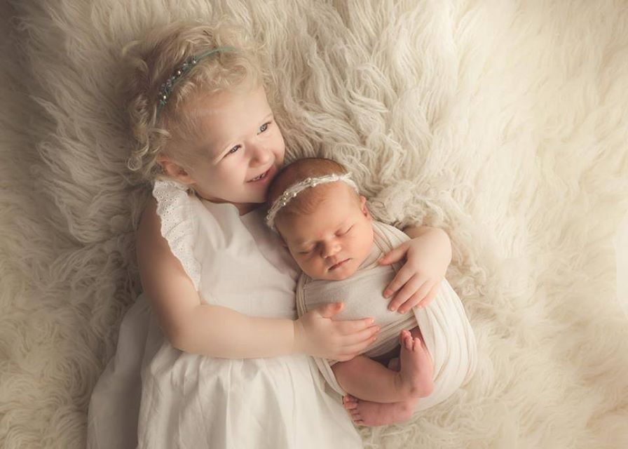 Picture of two girls - toddler and baby sister