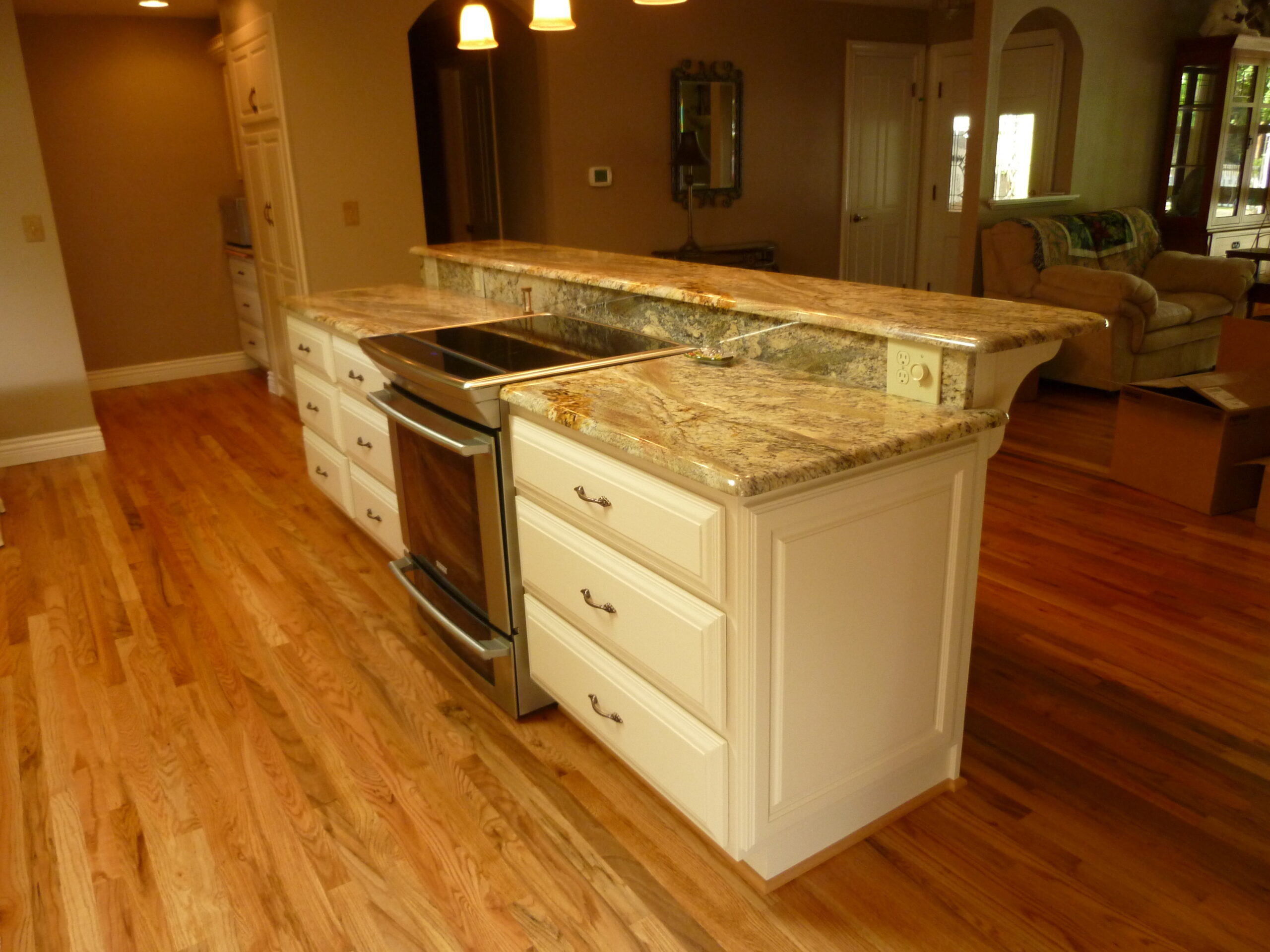 Kitchen island with stainless steel oven and electric stovetop