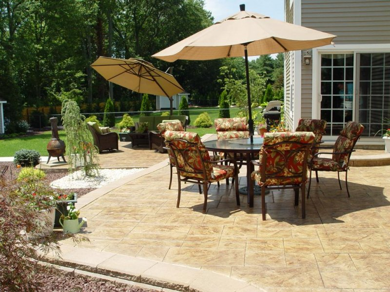 Stamped Concrete Patio with a Paver Wall