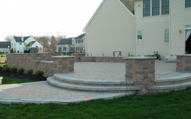 Raised Paver Patio with Outdoor Kitchen, Retaining Wall, & Columns