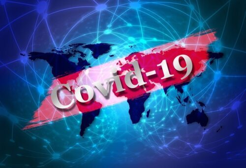 A global map with Covid-19 written across it.