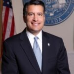 Governor Brian Sandoval praises Russell for his efforts in autism advocacy