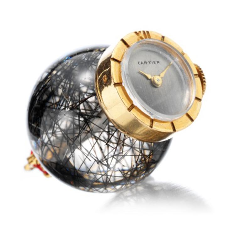 A Rutilated Quartz and Gold 'Coronation' Clock, by Cartier, circa 1953