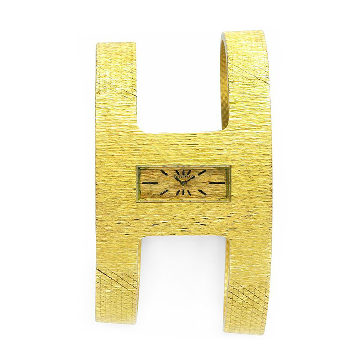 An 18k Gold Textured Gold Wristwatch, by Tiffany & Co., circa 1960