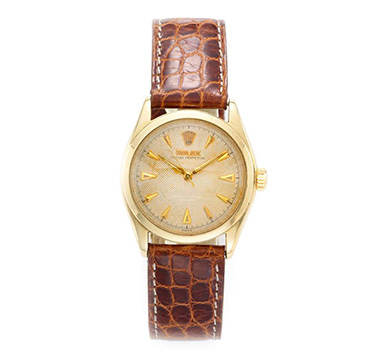 An Oyster Perpetual Gold Wristwatch, by Rolex, circa 1940