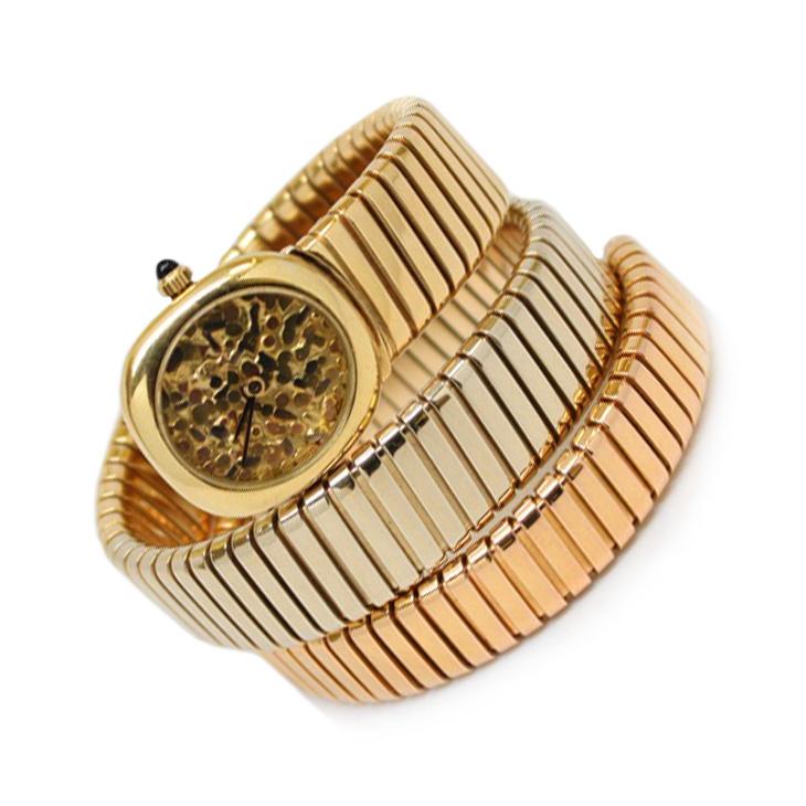 A Tri-colored Gold Tubogas Skeleton Dial Wristwatch, by Bulgari