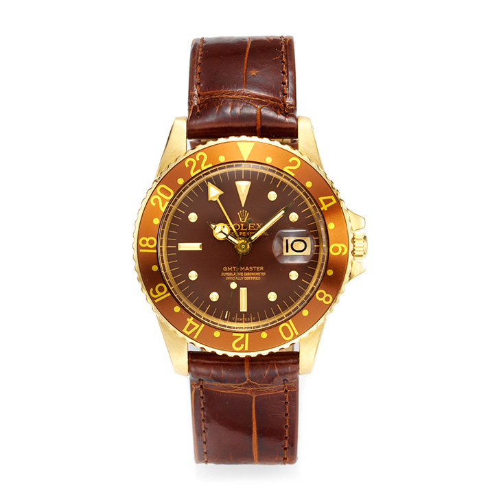 A Gold Oyster Perpetual Gold GMT-Master with 'Root beer' Dial, by Rolex