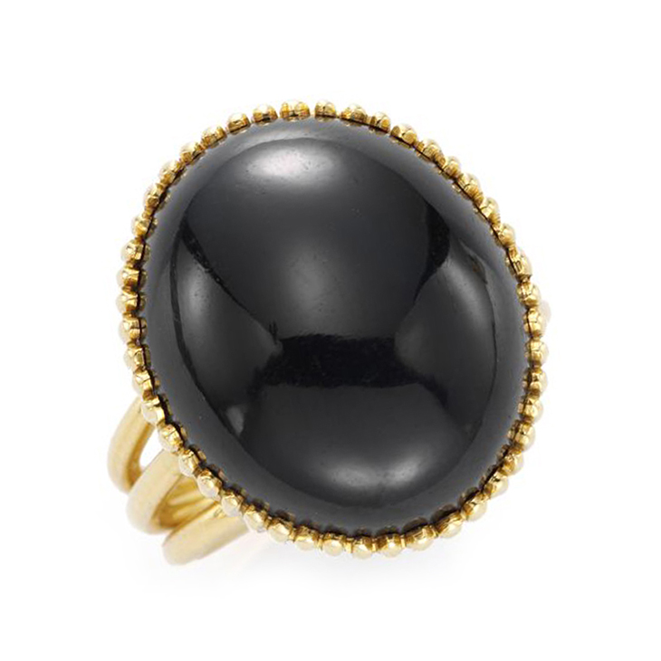 A Star Sapphire and Gold Ring, by Cartier, circa 1960