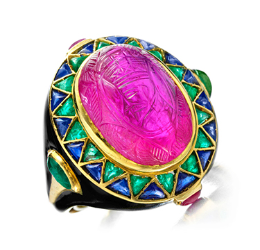 An Egyptian Revival Ruby, Emerald, Sapphire and Enamel Ring, by Cartier, circa 1928