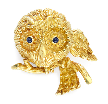 A Gold and Sapphire Owl Brooch, by Cartier, circa 1960
