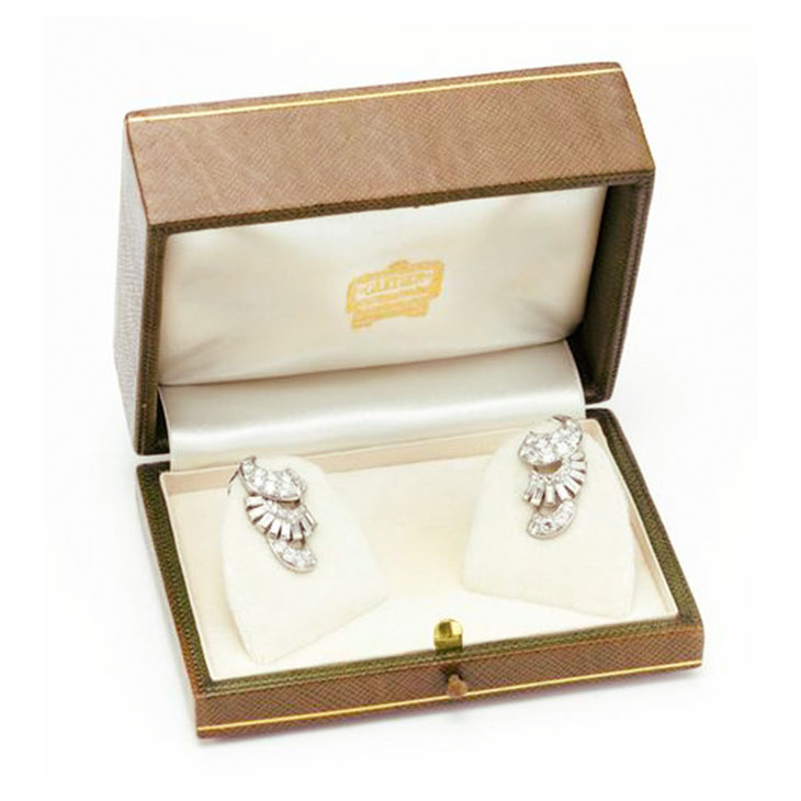 A Pair of Art Deco Diamond and Platinum Scroll Ear Clips, by Cartier, circa 1930