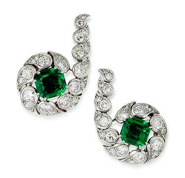 A Pair of Emerald and Diamond Ear Clips, by Cartier, circa 1950