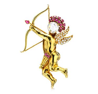 A Ruby and Diamond Cupid Brooch, by Van Cleef & Arpels