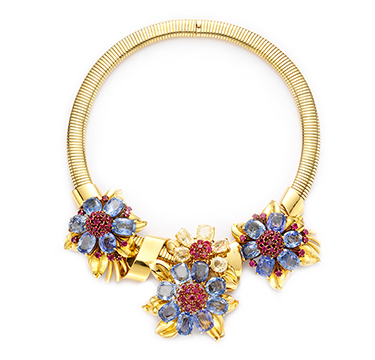 A Retro Blue and Yellow Sapphire, Ruby and Gold 'Passe-Partout' Necklace, by Van Cleef & Arpels, circa 1940
