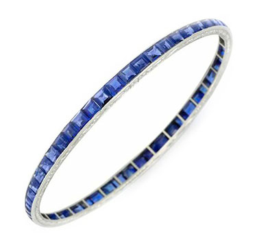 An Art Deco Sapphire and Platinum Bangle, by Van Cleef & Arpels, circa 1920