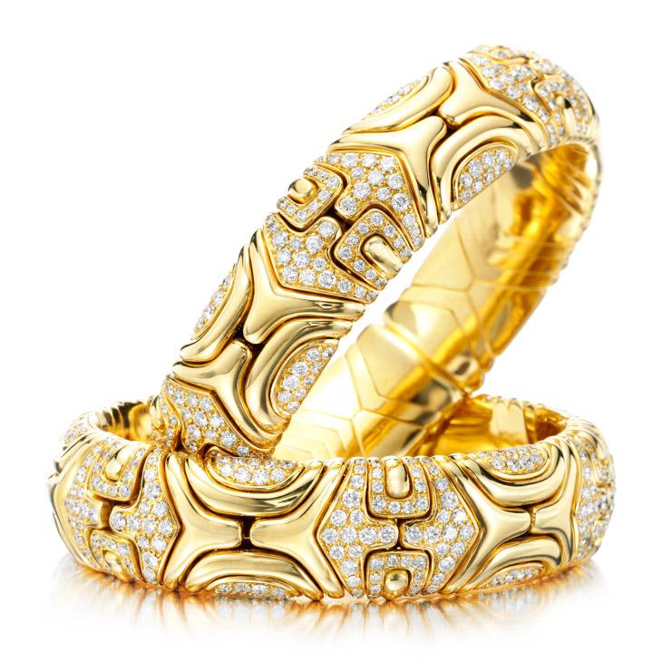 A Pair of Diamond and Gold 'Alveare' Cuff Bracelets, by Bulgari, circa 1988