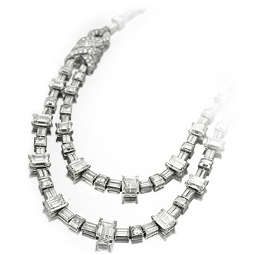 An Art Deco Diamond and Platinum Necklace, of approximately 75.00 carats, with maker's marks for Cartier London, circa 1928