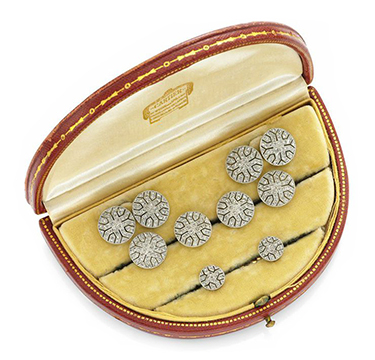 An Art Deco Diamond and Platinum Dress-set, in a fitted case, by Cartier, circa 1920