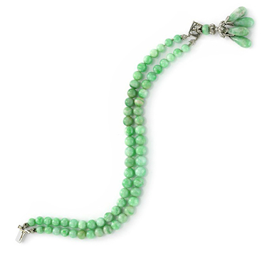An Art Deco Jade and Diamond Tassel Bracelet, circa 1920