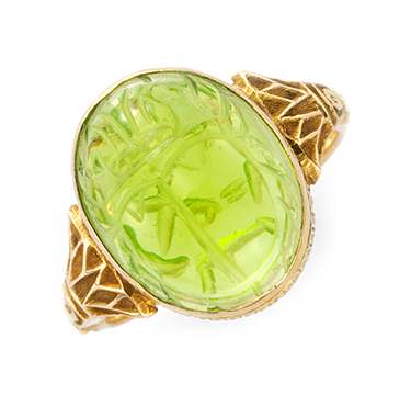 An Art Deco Carved Peridot Scarab Ring