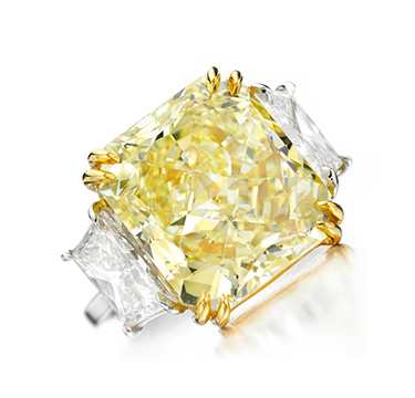 A Fancy Intense Yellow Diamond Ring, weighing approximately 16.00 carats