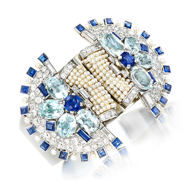 An Art Deco Natural Pearl, Sapphire and Diamond Cuff, by Cartier, circa 1930